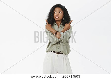 Concerned Troubled Attractive African American Adult Woman With Curly Hairstyle Feeling Unsure Cross
