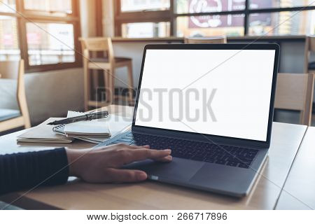 Mockup Image Of  A Hand Using And Touching Laptop Touchpad With Blank White Desktop Screen While Sit