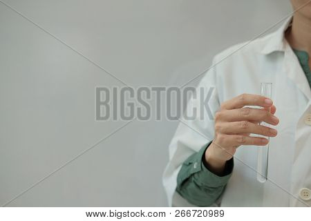 Scientist Working With Test Tube. Researcher Doing Research Investigation. Chemistry Biology Science