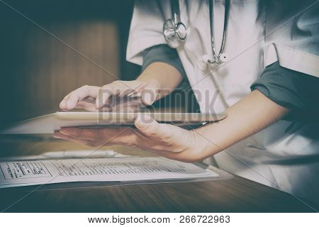 Physician Doctor Medical Practitioner Using Tablet Computer At Hospital Clinic