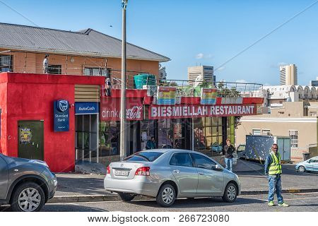 Cape Town, South Africa, August 17, 2018: A Street Scene, With The Biesmiellah Restaurant, People An