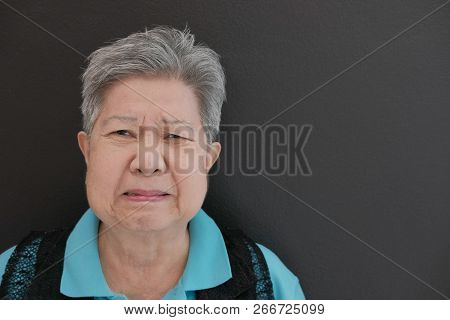 Furious Elder Woman, Enraged Elderly Female. Angry Asian Senior
