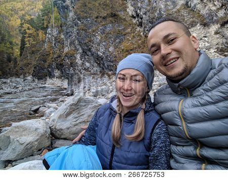 Tourists Rest After Hike And Take Selfie On The Phone. Photos From The Phone During The Hike. Family