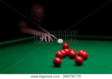 Man Trying To Hit The Ball In Snooker. Shallow Focus. Copyspace.