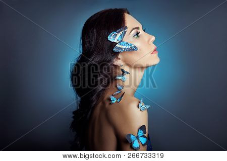 Beautiful Mysterious Woman With Butterflies Blue Color On Her Face, Brunette And Paper Artificial Bl