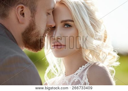 Man And Woman Love And Hugs, Close Relationship And Love, Couple In Love Standing On The Rocks Near