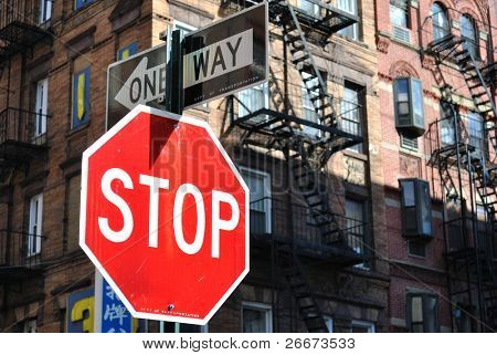 Stop sign and one way sign in New York City.