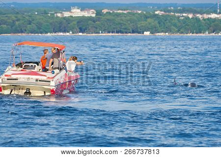Porec, Croatia - July 22, 2018: Tourists On A Boat Off The Coast Of Porec In Croatia In Search Of Do