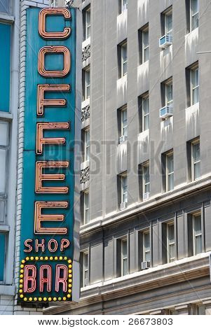 Retro diner sign in the city saying