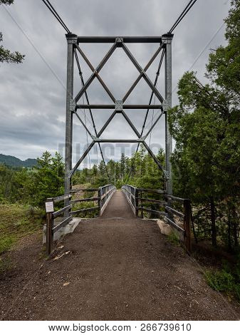 Entrance To Suspension Bridge In Yellowstone Wilderness