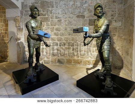 Dubrovnik, Croatia, July 29, 2018: Dubrovnik Clock Tower Bell Striking Bronze Figures, Supposedly De