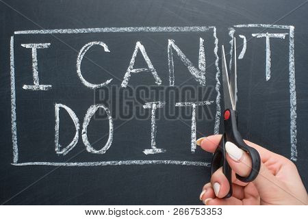 Using Scissors To Remove The Word Can't To Read I Can Do It Concept For Self Belief, Positive Attitu