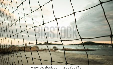 Volleyball Net In Front Of A Beautiful Southern Beach For Vacation And Volleyball At The Shore Of Th