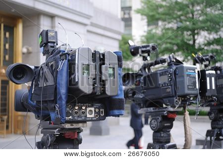 video cameras poised outside of a courthouse