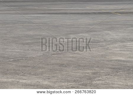 Empty Asphalt Airport Space. Grunge Asphalt Perspective Photo. Sunny Faded Grey Asphalt Background.