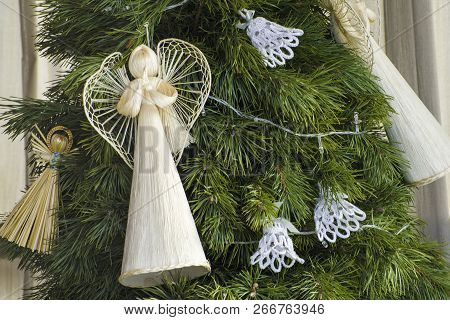 Lvov, Ukraine- January 20, 2018: Straw Christmas Angels On The Christmas Tree. Christmas Decorations