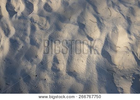 White Sand Beach Texture. Seaside Top View Photo. Sea Sand With Shadows Texture. Smooth Sand Surface