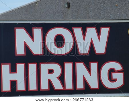 A Now Hiring Sign. It Is On The Side Of A 45-foot Semi Trailer. Looks Can New Deceptive At Times.