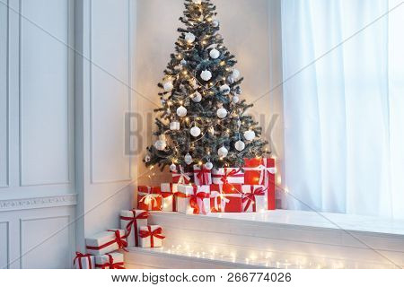 Vintage styled interior with a Christmas tree. Winter holidays concept.