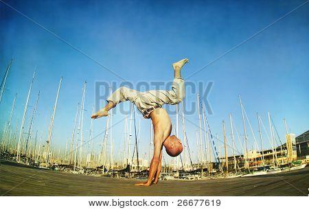 Dinamic handstand in blue sky