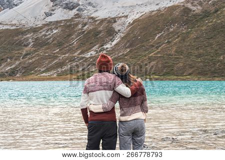 Hiking Young Couple Traveler Looking Beautiful Landscape At Milk Lake In Yading Nature Reserve, Trav