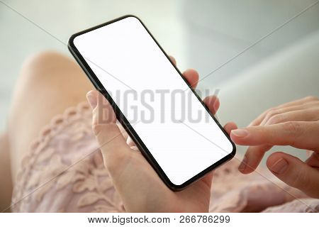 Woman In Pink Dress Holding Phone With An Isolated Screen