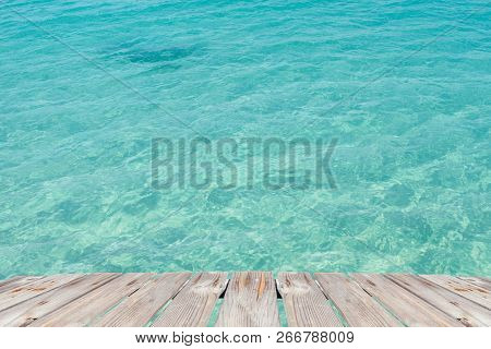 Empty Wooden Table With Crystal Clear Of Sea Background, For Product Display Montage