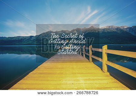 Inspirational Success Quotes On The Mountain Sunset Background. The Secret Of Getting Ahead Is Getti