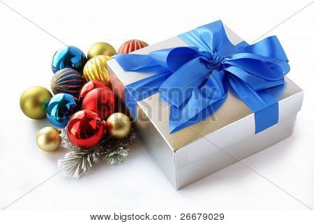 gift in siver box and multicolor glossy ornaments