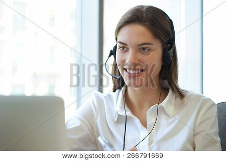 Customer Support Operator Working In A Call Center Office.