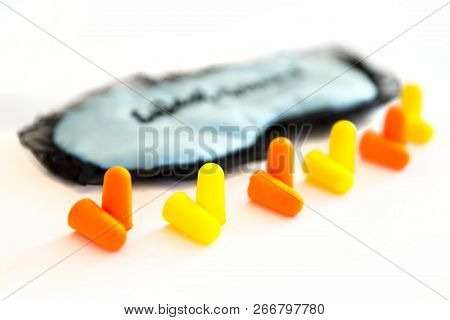 Sleeping Mask With Orange And Yellow Ear Plugs Isolated On A White Background. Sweet Dreams. Studio