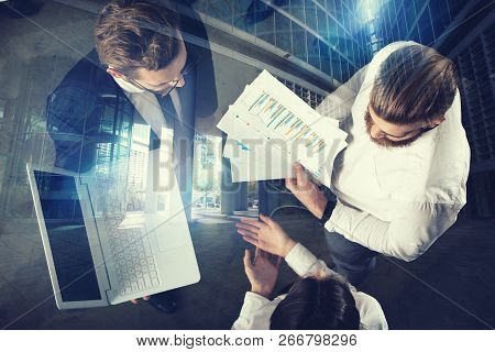 Business People Work In The Office With Statistic Worksheets. Concept Of Teamwork And Business. Doub