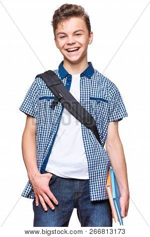Portrait Of Young Student With School Bag And Books. Teenager Smiling And Looking At Camera. Happy T