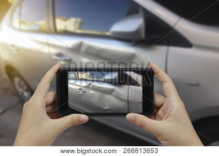 Hand Holding Smart Phone Take A Photo At The Scene Of A Car Crash And Accident, Car Accident For Ins