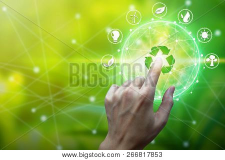 Finger Touch With Environment Icons Over The Network Connection On Nature Background, Technology Eco