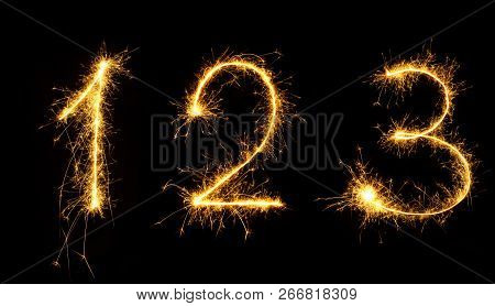Beautiful Set Of Fireworks Numbers 1,2,3 Close Up. Burning Sparkler Numbers Isolated On Black Backgr