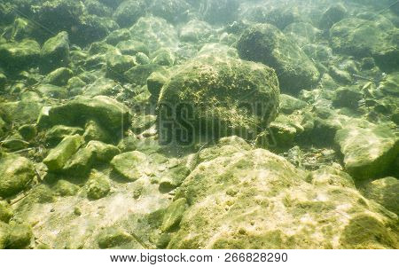Underwater Rocks At The Seaside. May Be Used As Background