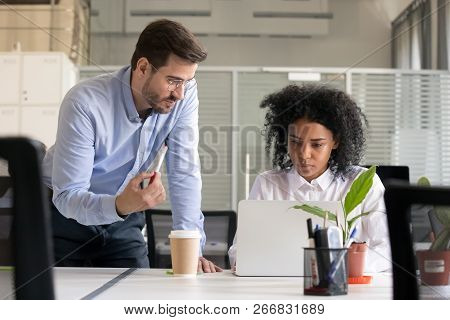 Mentor Or Leader Speaking Helping African Intern With Computer W