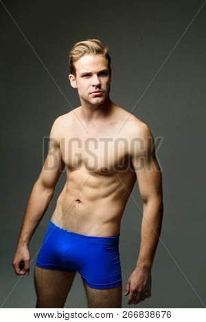 Handsome Sexy Sporty Man. Muscular Man With Naked Torso Wearing Blue Underwear. Muscular Male Model