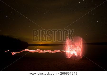 Light Painting By Lake With Stars And Clouds.