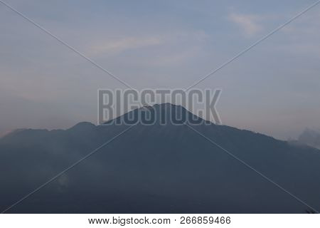 Mounain Arjuna, Panorama. Natural Landscaping, Background Of Overcast Sky