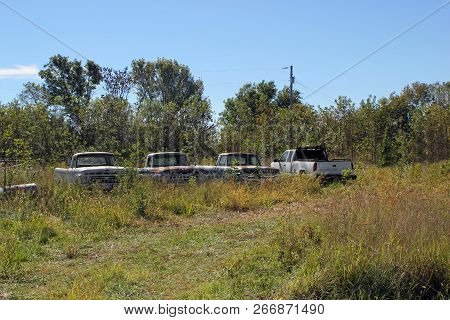 Fairland, Ok - October 09: Old Used Trucks Parked In Rural Vacant Lot 2013