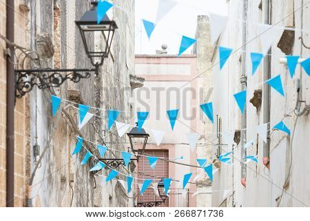 Presicce, Apulia, Italy - Blue And White Bunting In The Streets To Celebrate