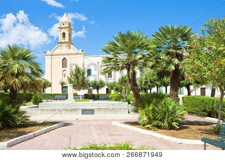 Presicce, Apulia, Italy - Relaxing In The Calm Park In Front Of The Church