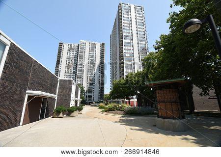Carl Sandburg Village high rise condominiums under a clear blue sky in Summer, Chicago poster