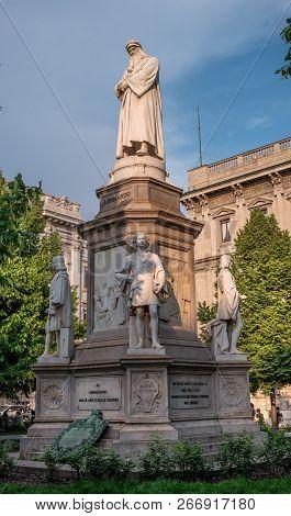 Milan, Italy - 09 May 2018: Monument To Leonardo In Piazza Della Scala. The Monument Is Illuminated