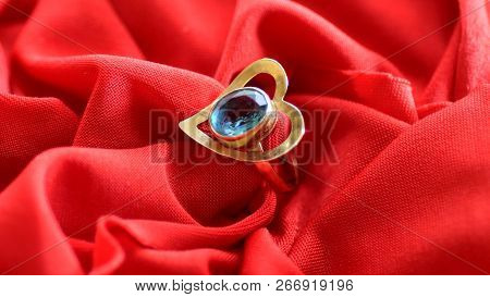 Close Up Of Red Satin Fabric Background