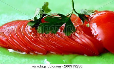 Close Up Of Olive Oil Over Tomato Slices