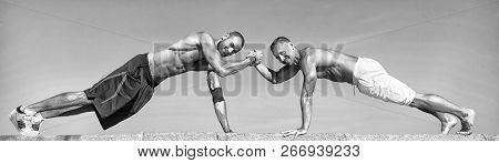 Push Ups Challenge. Men Motivated Workout Together. Sportsmen Improves His Strength By Push Up Exerc