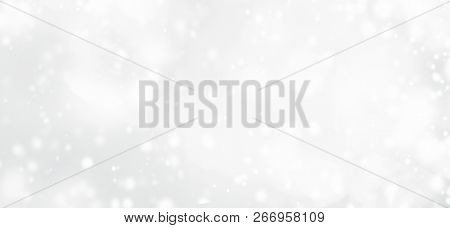 Silver  Abstract Bokeh Background With Snowflake And White Glittering Bokeh Stars. A Shiny Holiday C